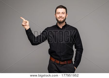 Young Handsome Businessman With Beaming Smile Pointing With Finger