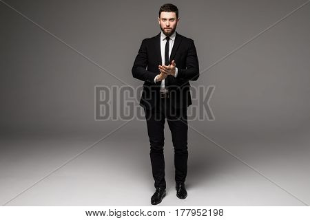Full Length Of Confident Young Businessmen Standing Isolated On Grey