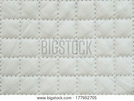Closeup surface fabric pattern at the old white fabric oven glove for cooking isolated on white background
