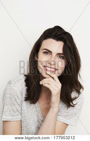 Gorgeous lady smiling to camera studio shot