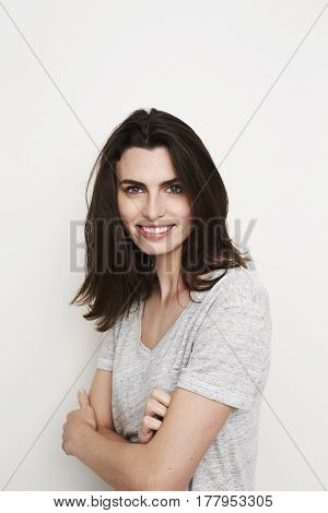 Young beautiful Smiling brunette woman portrait studio
