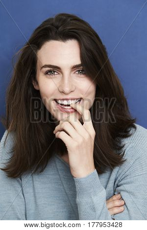Young Laughing green eyed beauty in studio
