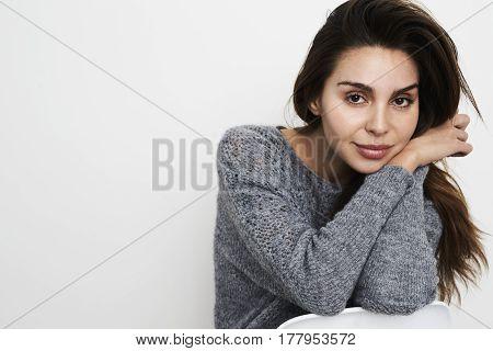 Cute Brunette babe in grey sweater portrait