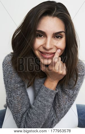 Beautiful smile babe in studio portrait brunette