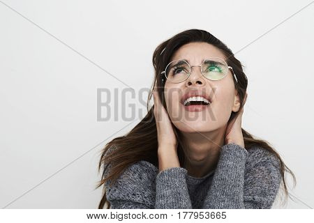 Beautiful woman looking up in disappointment studio