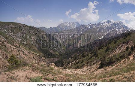 Panorama of Chimgan mountains, Uzbekistan, on a sunny day