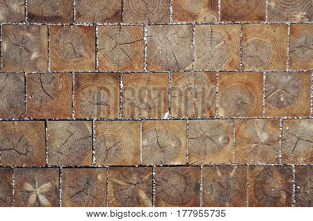Wooden blocks pavement texture. Natural background.