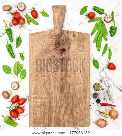 Cutting board and vegetables. Healthy food detox clean eating diet vegetarian nutrition