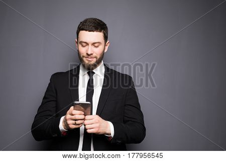 Handsome Stylish Young Man Writing Sms On Phone.