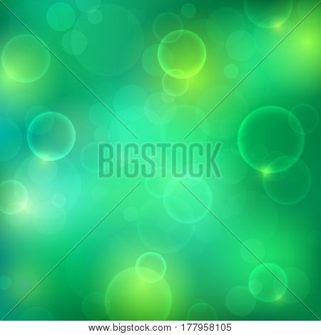 Shining green background with light effects. Magic defocused glitter sparkles. Blurred soft backdrop. Vector illustration. EPS10