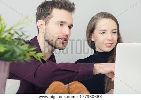 Couple Cooperates With The Computer In The Office