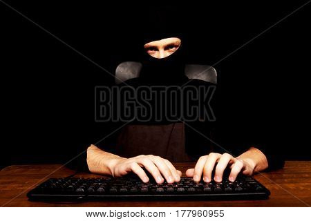 Dangerous hacker in black balaclava
