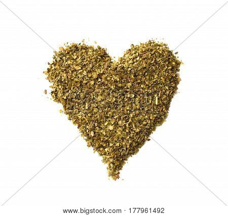 Heart Made Of Spilled Dried Majoram Heap Isolated On White Background