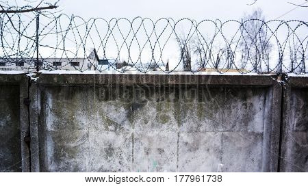 Concrete Wall, Against The Backdrop Of Barbed Wire, The Concept Of Prison, Salvation, Refugee, Lonel