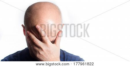 Portrait Of A Stressed Sad Bald Man On White Background, Covering Eyes With Hands, Hair Loss Baldnes