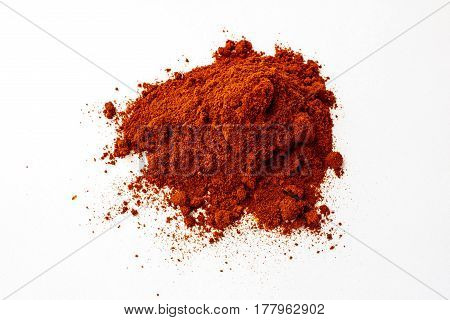 Heap Of Spilled Grounded Dry Red Pepper With Small Clumps Isolated On White Background