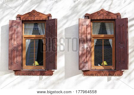 Vintage windows with sand wall background