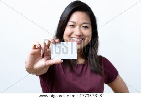 Smiling Chinese Woman Holding A Business Card