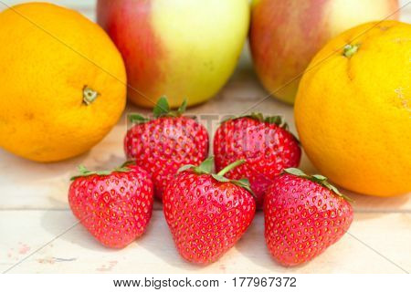 Apples, Oranges And Strawberries On Wooden Table Top View