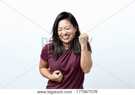 Exuberant Young Chinese Woman Cheering