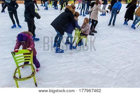 Adults And Children Skating.