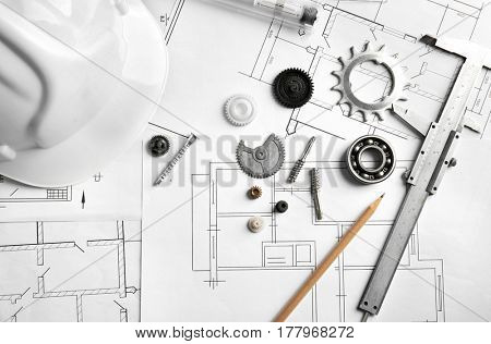 Different kinds of engineering tools on construction drawings background