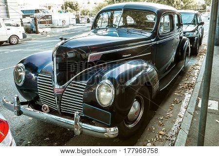 Hobart, Tasmania, Australia - January 16, 2015: Dodge four door Sedan, version 1939, shot taken on the road in Hobart center, close to the port.