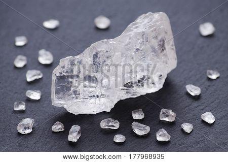 salt crystals on black background, selective focus