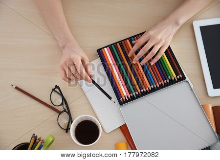 Female decorator working in office