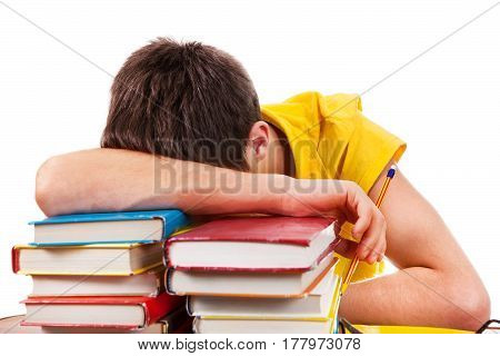Tired Young Man sleep on the Books
