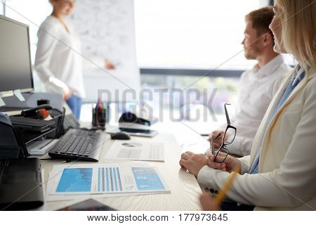 business and people concept - team at presentation in office