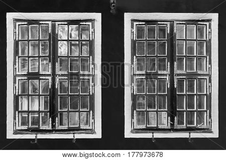 Contrast black and white vintage windows with  reflections