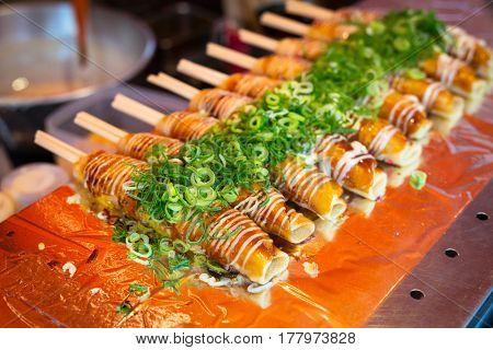 Japanese street food in Kyoto. Okonomiyaki