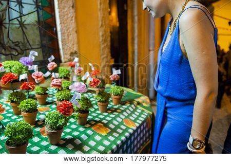 Lisbon Portugal - June 12 2014: Small bases with basil (manjericos) being sold in the Alfama neighbourhood during the Saint Anthony Feast in Lisbon Portugal