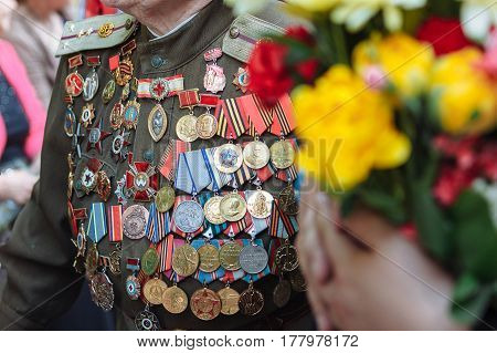 UKRAINE, KIEV - MAY 9:, veteran is awarded with many orders and medals. Parade of victory. Kiev, May 9, 2016