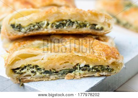 Spinach And Cheese Pie Slices On A Tray