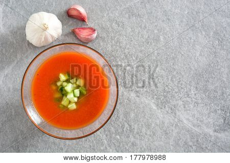 Traditional Spanish cold gazpacho soup on gray stone.Top view