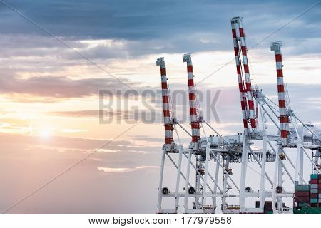 Close up of gantry crane bridge in shipyard on sky background and with copy space for text or your subject for logistics Import-Export.