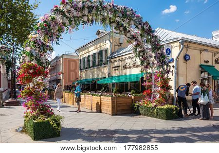 MOSCOW - AUGUST 7 2016: Flower arch on Klimentovsky lane .This area was reconstructed and became pedestrian in 2014.