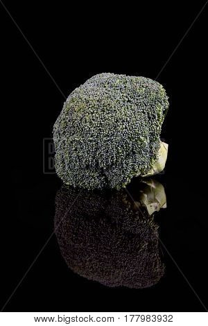 Broccoli florette isloated with black background and reflection