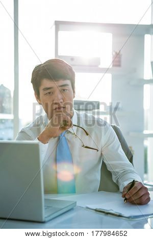 Serious businessman on his desk in office