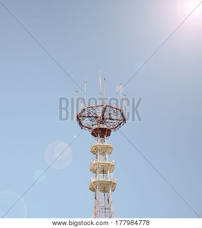 Cellular antennas on a blue sky background
