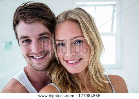 Happy couple hugging at home in the bathroom