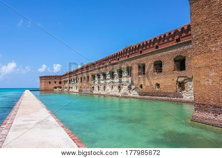 Northern Side of Fort Jefferson on Dry Tortugas National Park, Florida. The brick moat around Fort Jefferson with the crystal clear waters of the Gulf of Mexico surround it.