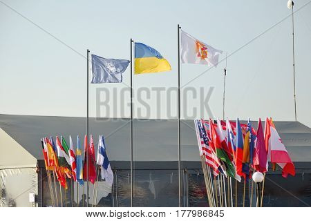 Flags of different countries waving in outdoors