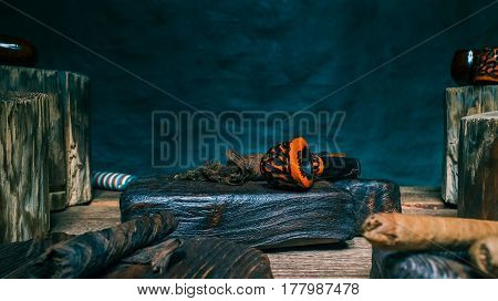 Cigars, tobacco and smoking pipes on wood boards. Dark background. Close-up view