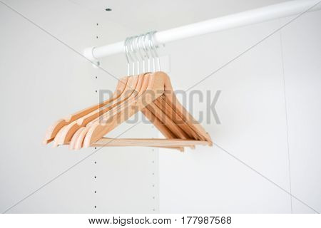 Wooden Coat Hangers In White Clean Simple Minimalistic Empty Cabinet