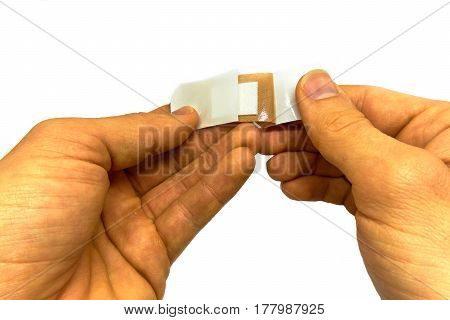 man attaching a plaster isolated on white background