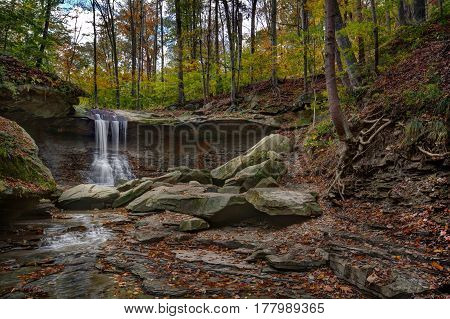 Beautiful autumn scene at Blue Hen Falls in the Cuyahoga Valley National Park near Cleveland Ohio.