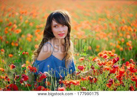 Beautiful Woman In Poppy Field